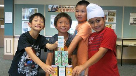Kidsday reporters, from left, Samuel Chan, Jason Chen,