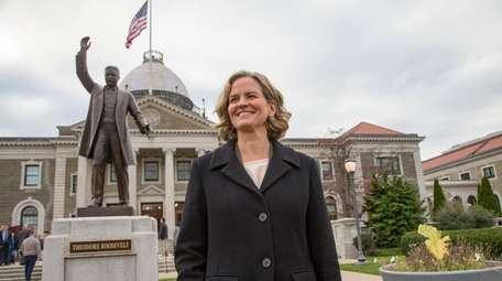 Nassau County Executive-elect Laura Curran speaks outside the