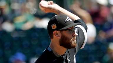 White Sox relief pitcher Matt Purke throws against
