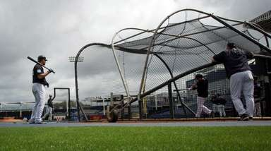 Yankees catcher Gary Sanchez looks on during spring training at