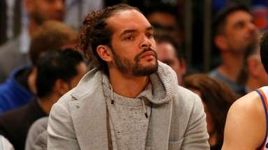 Joakim Noah of the Knicks looks on from