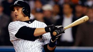Then-Yankees third baseman Aaron Boone watches his game-winning