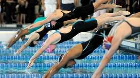 Sacred Heart Academy's Joan Cash swims in a