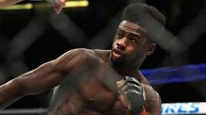 Aljamain Sterling, right, fights Renan Barao during their bantamweight