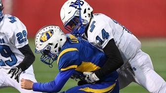 North Babylon's David Estrella tackles West Islip quarterback