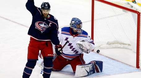 Blue Jackets forward Nick Foligno reacts in front