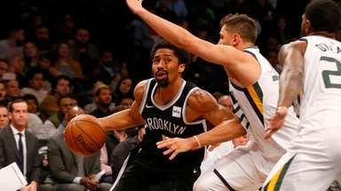 Nets guard Spencer Dinwiddie drives against Jonas Jerebko