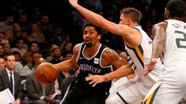 Nets guard Spencer Dinwiddie drives against Jonas Jerebko