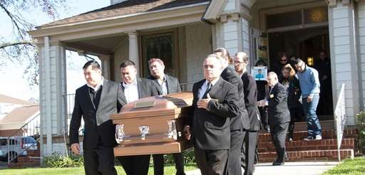 Pallbearers carry the coffin of Javier Castillo, 16,