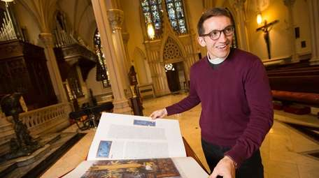 The Very Rev. Michael Sniffen looks through one