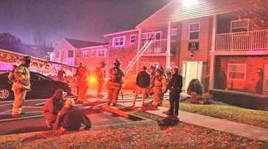 Firefighters respond to an apartment complex fire in