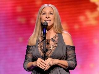 Barbra Streisand performs onstage during the tour