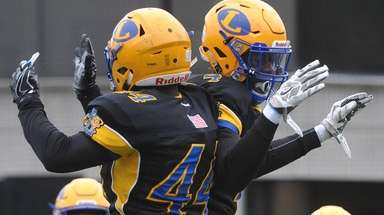Jordan Alexander #4 of Lawrence, right, celebrates with