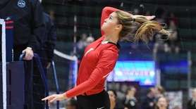 Mackenzie Cole of Connetquot about to spike the