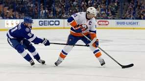 The Lightning's Steven Stamkos defends the Islanders' John