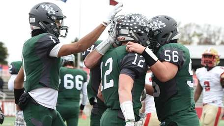 Teammates congratulates Westhampton's Dylan Laube after he rushes