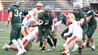 Westhampton's Dylan Laube carries the ball against Half