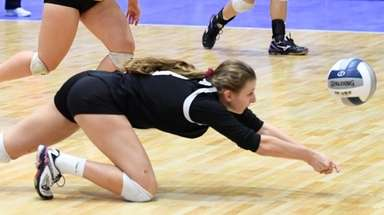 Haley Holmes of Kings Park diving for the
