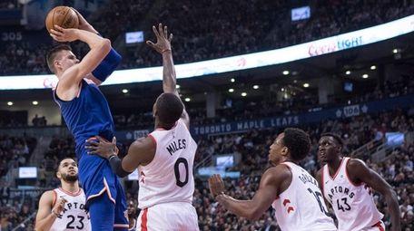 Knicks forward Kristaps Porzingis shoots during a game