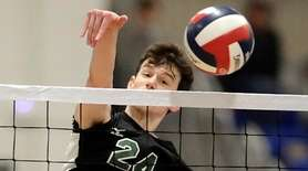 Bellmore JFK's Tyler Anderson (24) spikes the ball