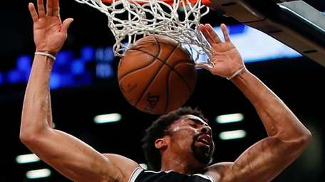 Nets guard Spencer Dinwiddie dunks the ball against