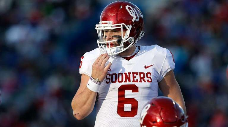 Quarterback Baker Mayfield of the Oklahoma Sooners prepares