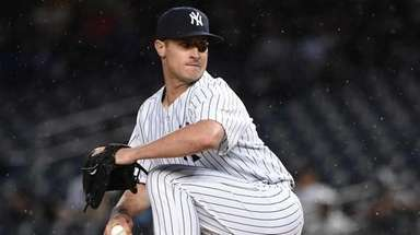 New York Yankees relief pitcher Nick Rumbelow delivers
