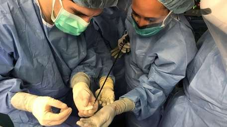 Two members of the surgical team at NYU
