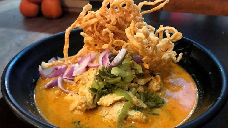 Khao soi, noodles in coconut-milk broth topped by