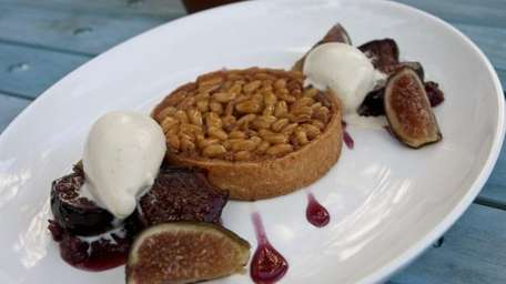 The honey-pine nut tart, served with fresh figs,