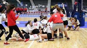 The Connetquot girls volleyball team celebrate after beating