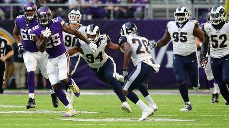 Latavius Murray of the Minnesota Vikings carries the
