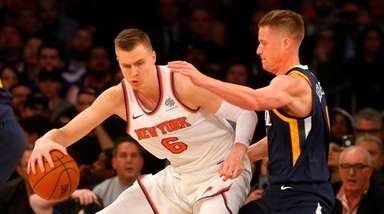 Kristaps Porzingis of the Knicks works against Jonas Jerebko