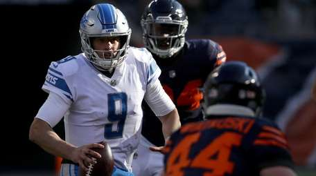 Matthew Stafford of the Detroit Lions carries the