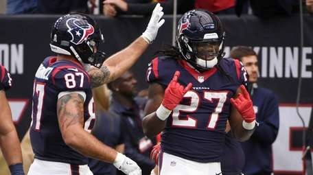 Houston Texans running back D'Onta Foreman celebrates with