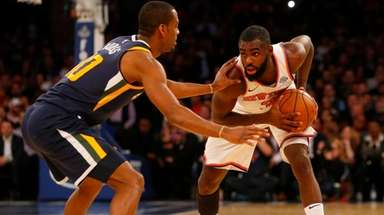 Tim Hardaway Jr. of the Knicks controls the ball