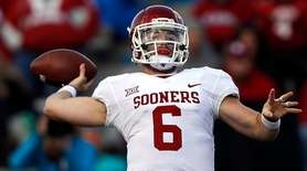Baker Mayfield of Oklahoma passes against Kansas at
