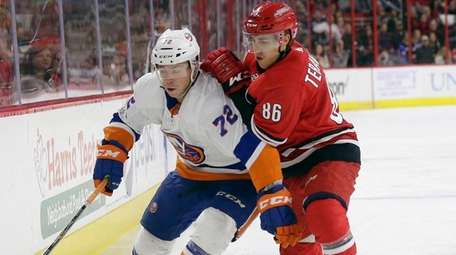 The Hurricanes' Teuvo Teravainen and the Islanders' Anthony