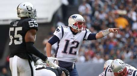 Tom Brady of the New England Patriots directs