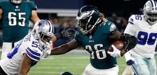 Philadelphia Eagles running back Jay Ajayi fights off