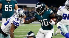 Philadelphia Eagles running back Jay Ajayi fights off