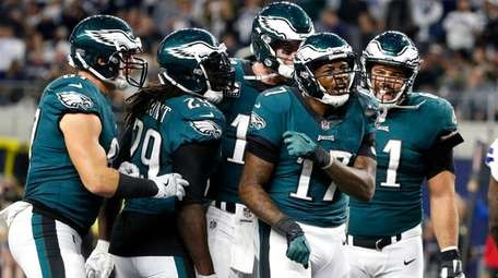 Eagles players celebrate a touchdown catch by Alshon