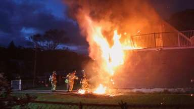 Firefighters battle blaze at a house on Center