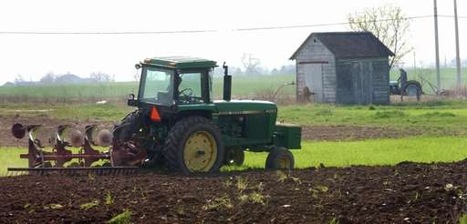 A tractor on a farm.