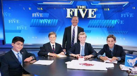 Fox TV personality Greg Gutfeld with Kidsday reporters,