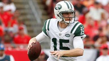 Josh McCown of the Jets looks for a