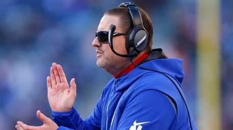 Ben McAdoo of the Giants reacts against the