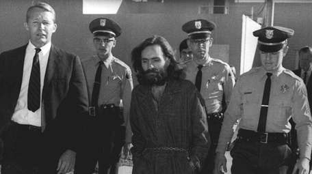 Charles Manson is escorted to court in Independence,