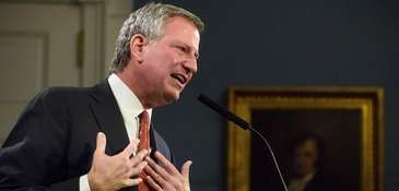 Mayor Bill de Blasio speaks to members of