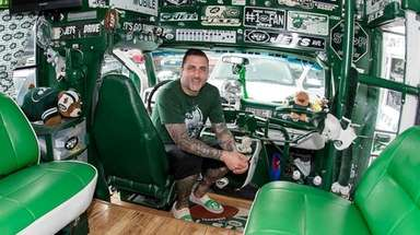 Kurt Paschke of Holbrook poses in his van,
